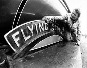 Woman polishing the Flying Scotsman's nameplate  May 1980.