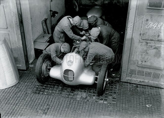 Mechanics working on a Mercedes-Benz racing car  Berlin  1934.