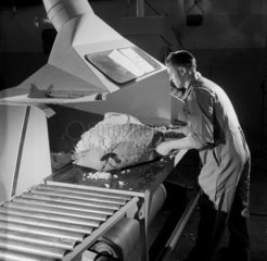 A production worker with slab of asbestos material  Turner Asbestos