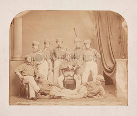 Group of performers  late 19th century.