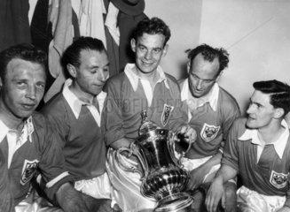 Stanley Matthews (1915-) and team mates hol