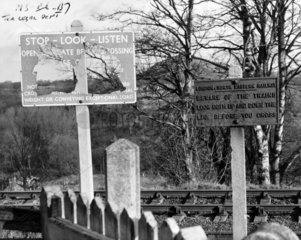 Damaged railway notices  Wales  January 1964.