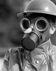 Man wearing a gas mask  c 1930s.
