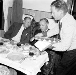 Waiter serving first class passengers on the 'Hook Continental'  20 June 1961.
