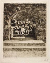 Children seen through an archway  1913.