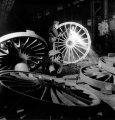 Burning the excess metal off the rough  unmachined  driving wheel  c 1958.