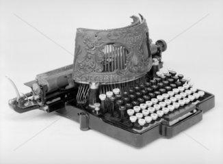 Bar-lock typewriter  1889. Designed by Char
