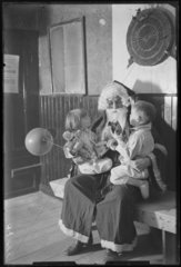 Father Christmas with two children  1932.
