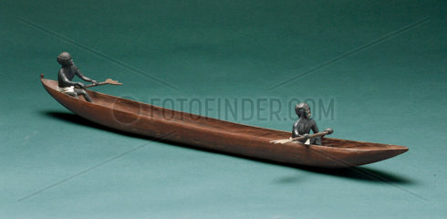 Canoe hollowed from a tree trunk  with two figures  1931.