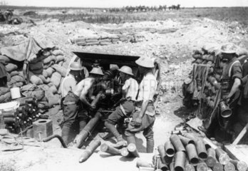 Soldiers loading ammunition into a gun  Wes