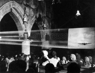 Audience watching a war film  30 December 1941.