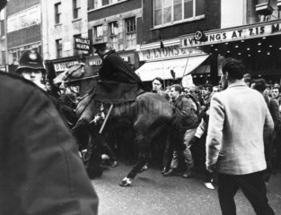 Mounted policeman and CND marchers  April 1963 or 1965.