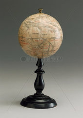 Mars globe on a black wooden stand  1892.