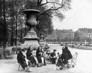 Nursemaids and children in a a park  Paris