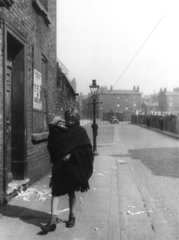 'One of Liverpool's little mothers'  c 1937