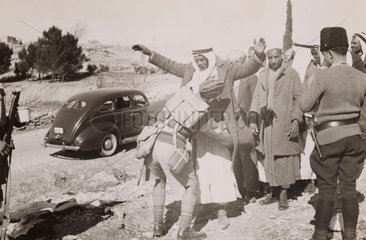 A British soldier searching a man  Palestine  1938.