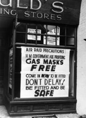 Poster in shop window advertising gas masks  1939-1945.