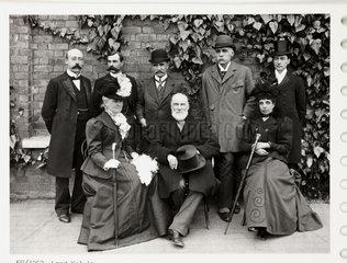 Victorian group in a garden  c 1900.