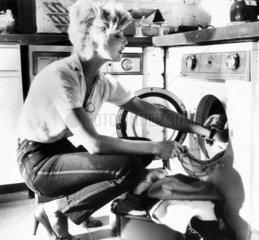 Woman loading a Philips washing machine  1988.