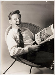 Boy laughing at a cartoon  1959.