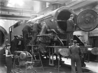 Working on a locomotive  Bristol  c 1934-1938.