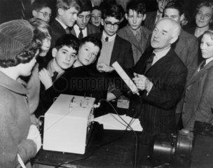 Dr T E Allibone demonstrating a Geiger counter  1959.
