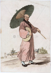 A Japanese man in a kimono with a parasol and hat  19th-20th century.