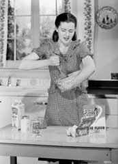 Woman making a cake  c 1950.