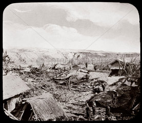 Villagers on the site of houses devastated by earthquake  Japan  1876.