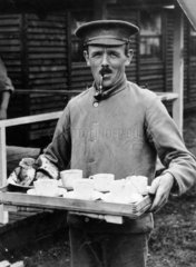 British soldier taking five o'clock tea to his comrades  1914-1918.
