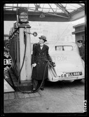 Filling a car with 'Coalene' petrol  1935.