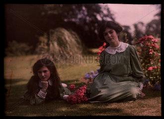 Two girls in a garden  1908.