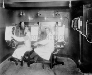 Projection booth with two operators  c 1910.