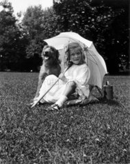 Little girl and dog  c 1930s.