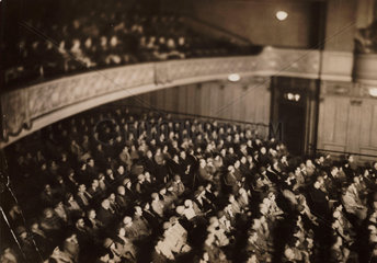 Audience photographed in infrared light  1930s.