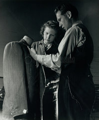 Man and woman inspect coat on dummy at clothes factory  Crewe  1948.