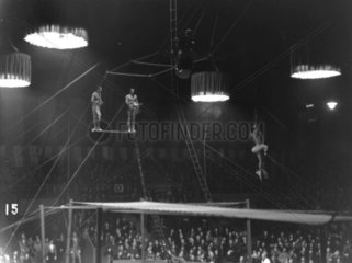 Circus tightrope walkers in action  c 1930s