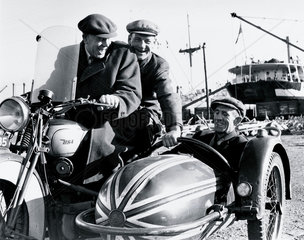 Fred  George and their companion riding a BSA motor-cycle combination  1940.