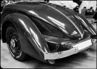 Rear view of a streamlined motor car  c 1934.
