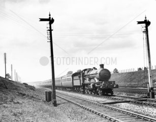 Star Class 4-6-0 steam locomotive. An up G.W. express  possibly near Iver.
