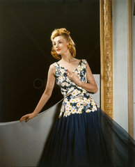 Model wearing a floral dress with net skirt  1940s.