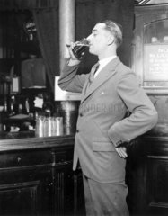 Man drinking a glass of beer  23 April 1931.