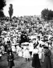 Large crowd of Sunday School children singi