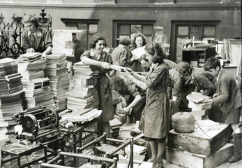 Women sorting clearing up after a German bombing raid  1940s.