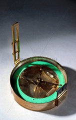 Brass framed compass  with two levels and eyepiece.