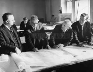 Sir John Brocklebank (left) discusses Q4 plans with colleagues  21 January 1964.