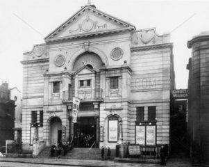 Boys standing outside the 'Ideal' cinema  Lambeth  c 1930s.
