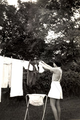 Woman hanging out washing  England  1960s.