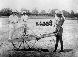 Measuring land for cultivation  Allahabad  India  1877.