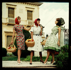 Three women with baskets  1960s.